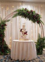 wedding floral arch burgandy roses foliage Fermanagh