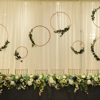 top table hired floral display wedding greenery