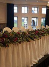 burgundy top table floral display