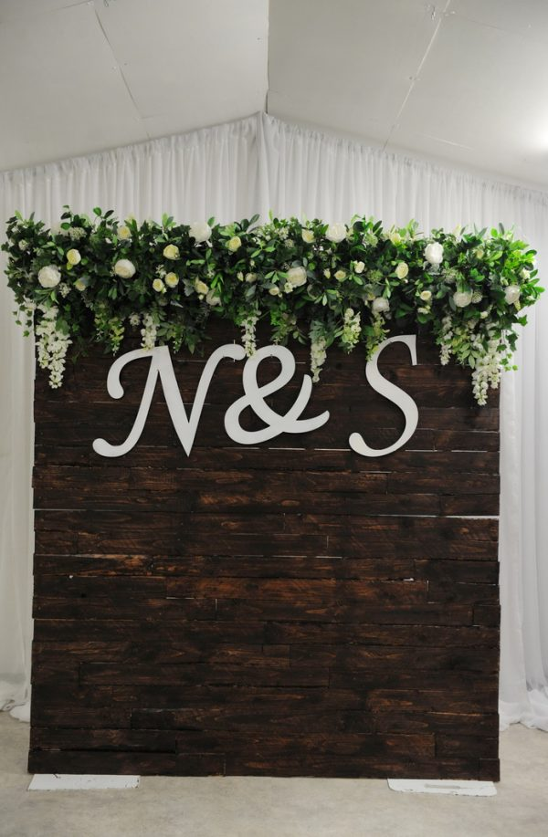 timber floral backdrop with letters intials