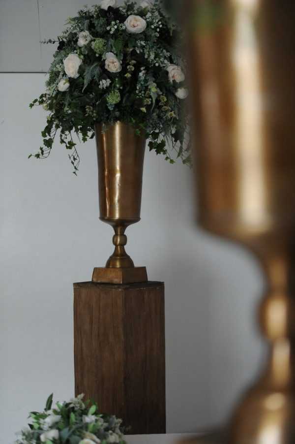 wild floral display on timber plinth