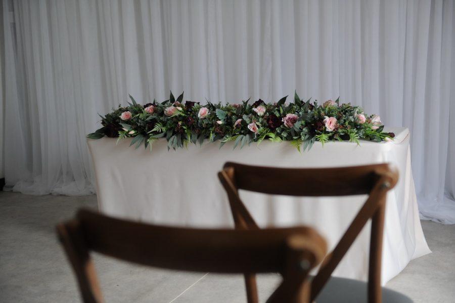 burgundy boho ceremony display