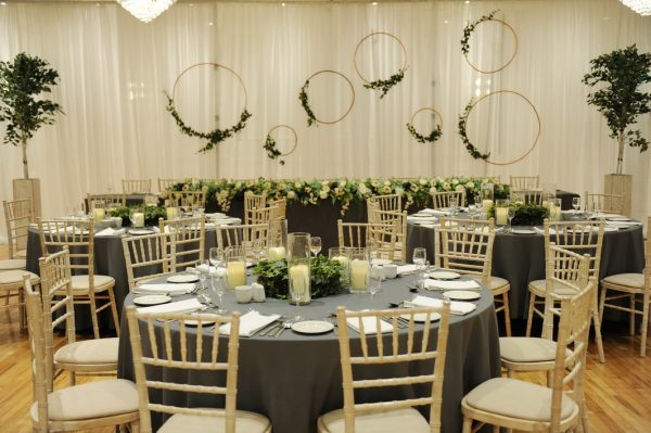 hooped botanical top table backdrop