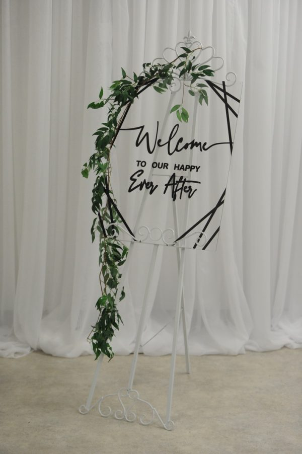 black and white geometric wedding sign with easel