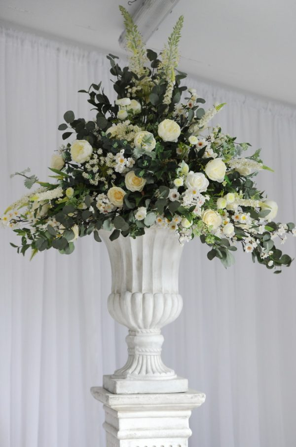 floral display with stone plinth