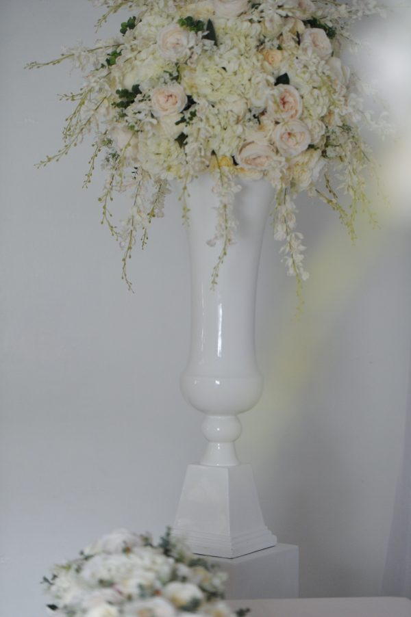 Cream floral display with pearl plinth