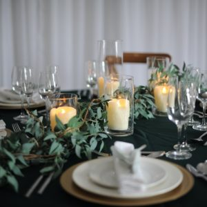 Trailing foliage and glassware